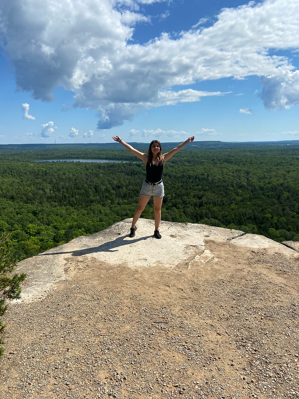 Rebecca standing on a clear vista on the Cup and Saucer Trail, Manitoulin Island