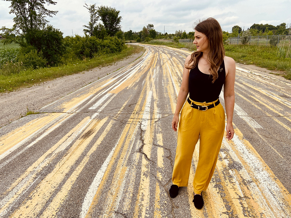 Rebecca stands looking at the crazy paint job of the Pleasantville Curve