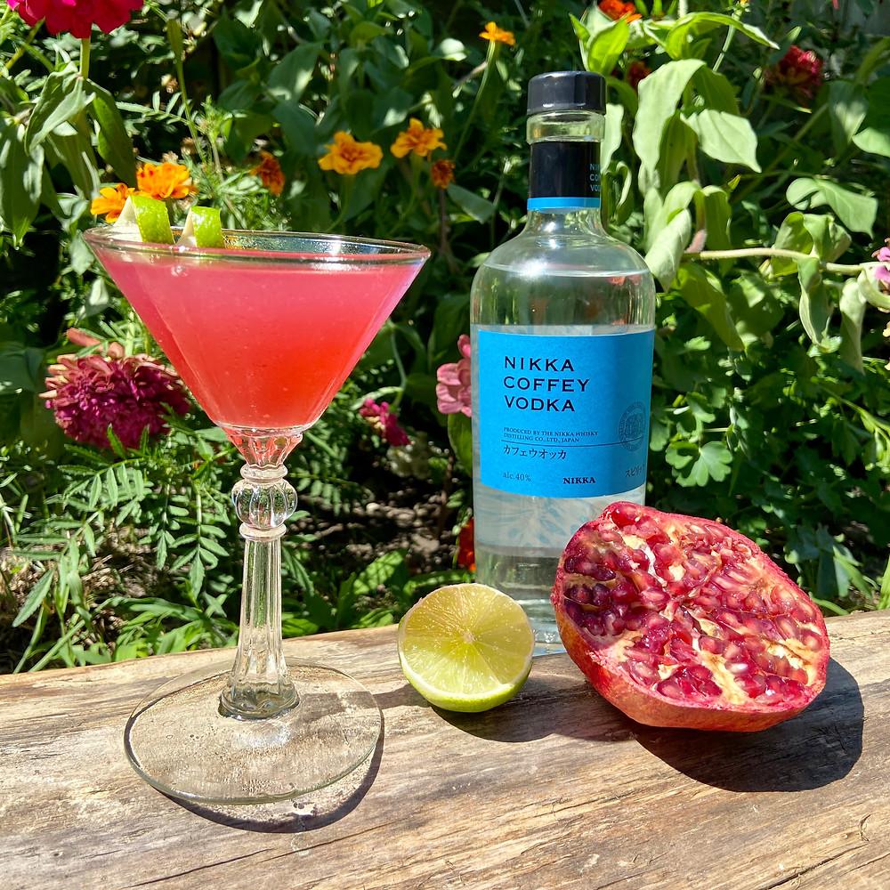 A pomegranate cosmopolitan cocktail made with Nikka Whisky