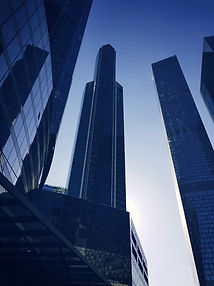 blue-glass-paneled-buildings-under-clear