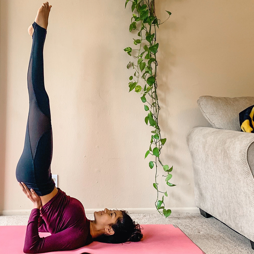 Steaches the queen of asanas, shoulder stand, as her favorite yoga posture to improve metabolism.