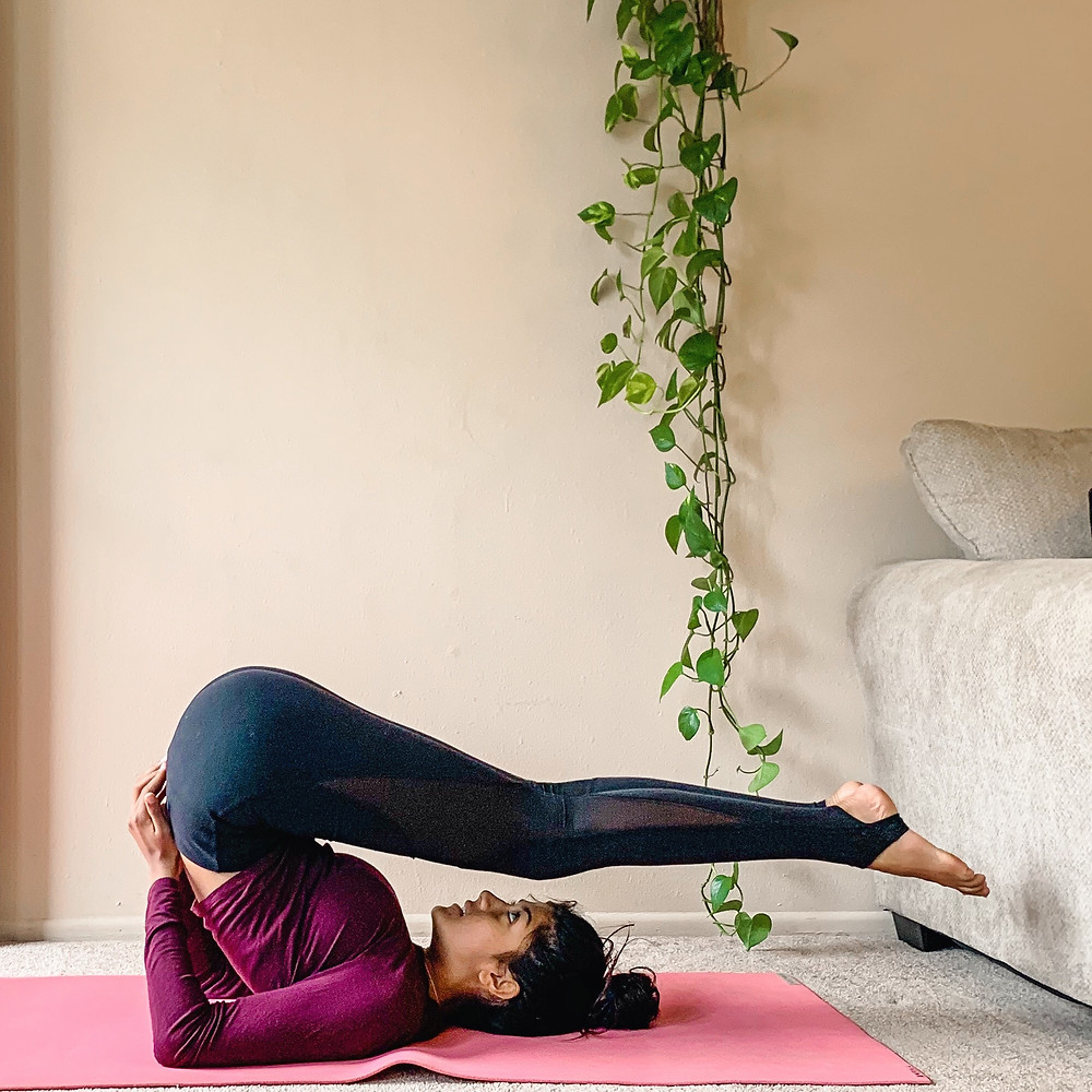 Super Batter owner Amby demonstrates plow pose as one of the three best yoga moves to improve metabolism.