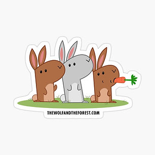 three bunnies, one is eating a carrot
