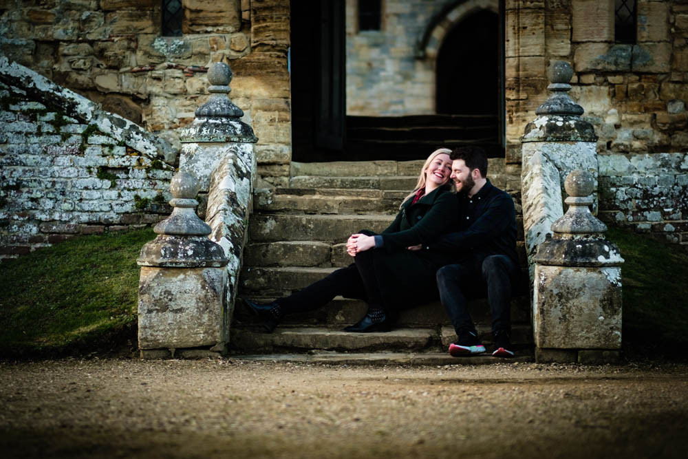 young couple relax at the bottom of stone steps