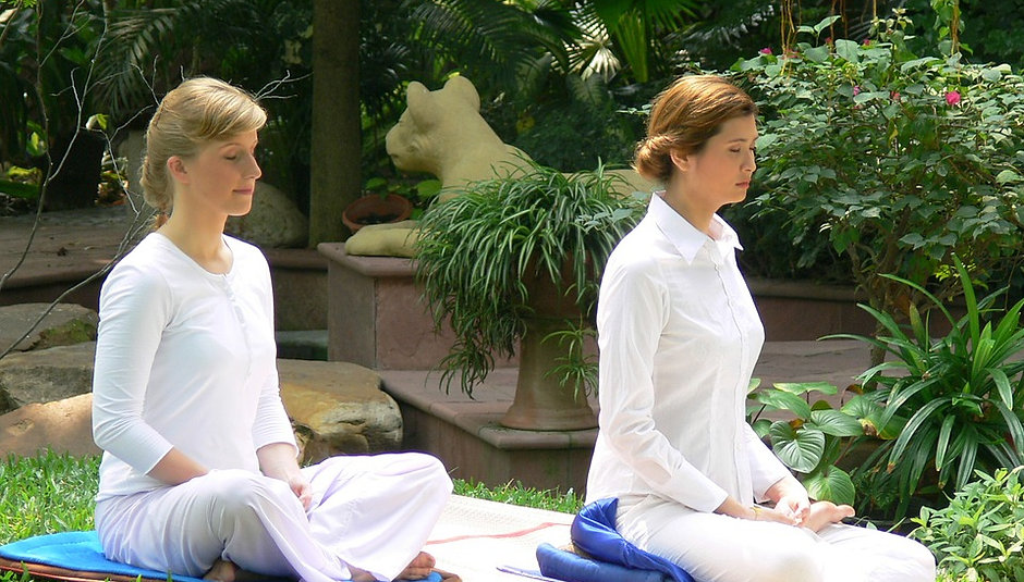 Two women are meditating.