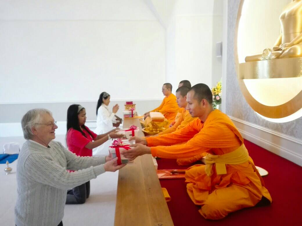 Monks are receiving gift.