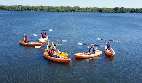Young family having fun kayaking with te