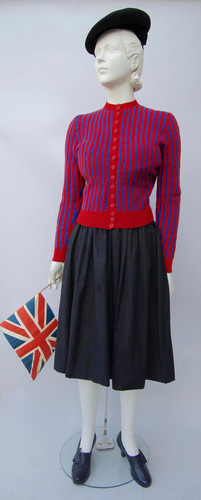 Black cotton skirt and red and blue striped cardigan sweater (1944-1946)