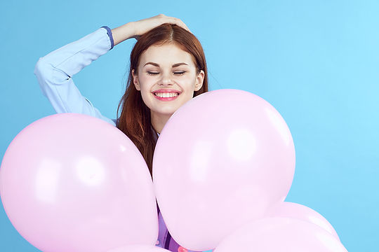 Girl with pink baloons.jpg