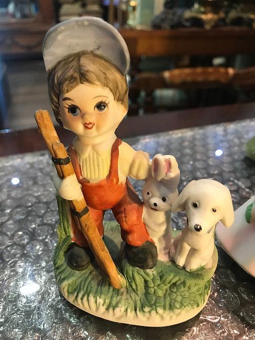 Юный охотник с зайцем и собакой