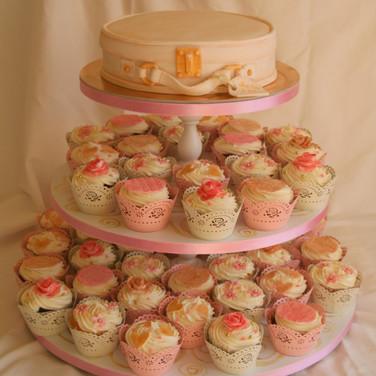 suitcase gold pink cake