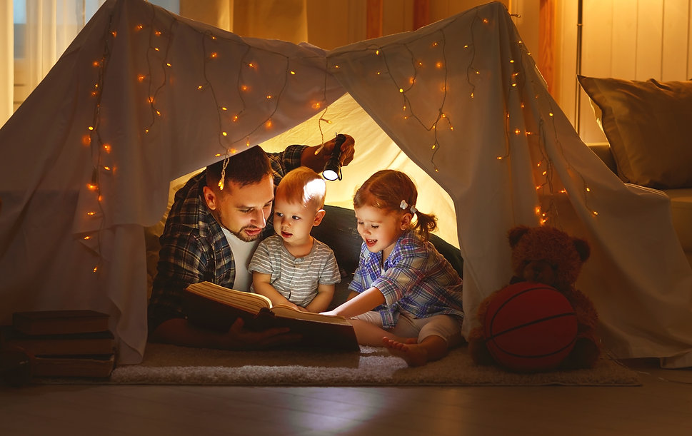 happy family father and children reading