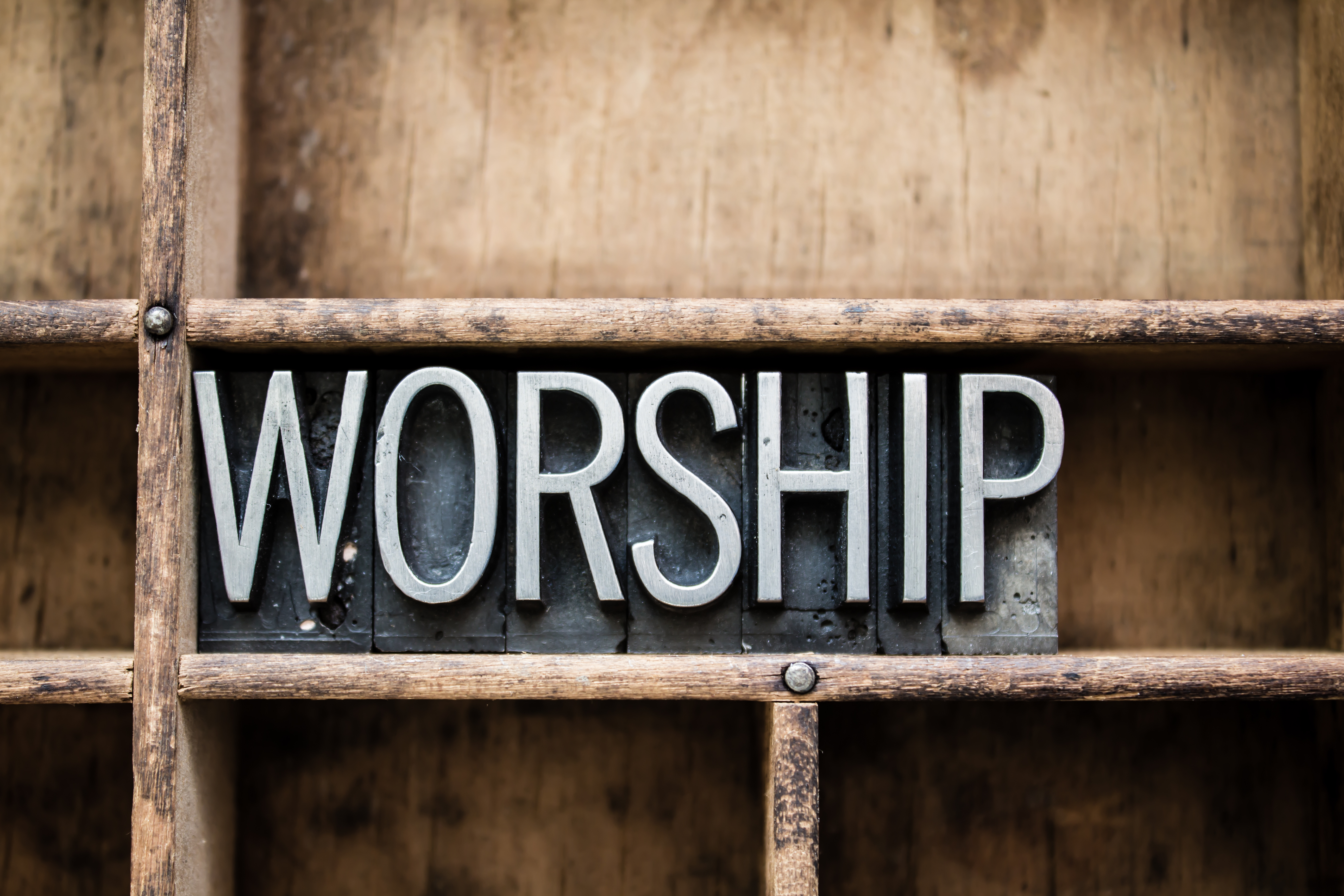 "The word ""WORSHIP"" written in vintage me"
