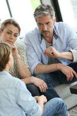 Parents having a talk with teenage boy