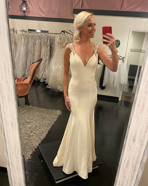 Simple elegance and a gorgeous back! Size 2 in store now.