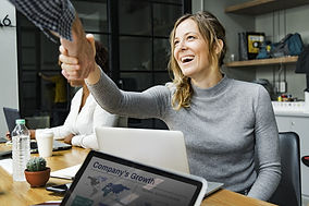 Woman at laptop shaking hands.jpg