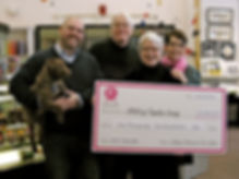 Bettsie and Ken present a check for $1250 to the SPCA.