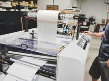 D&K AutoKote Pro automated laminating system