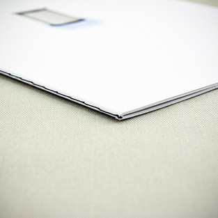 Design Marmo spine-sewn booklet with spot ClearCoat varnish