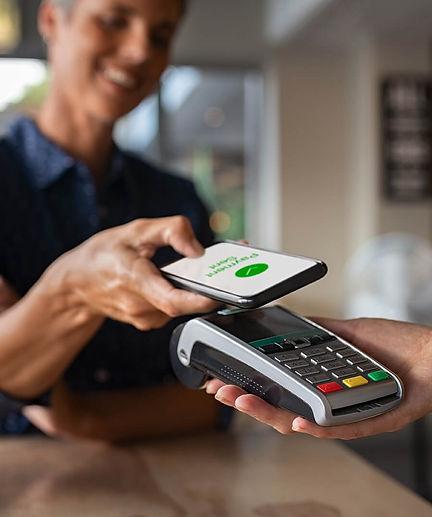 woman-paying-using-nfc-technology-2TQSZ9