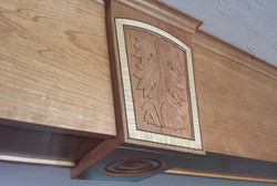 Architectural detail in cherry, carved acanthus with tiger maple and ebony inlay