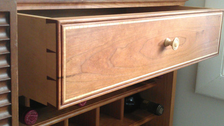 Cherry wine storage cabinet with maple inlay