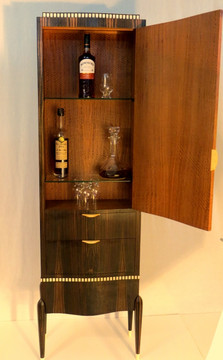 sumptous sapele interior, two bottle shelves, one for glasses, and a pair of drawers for additional glassware and treats