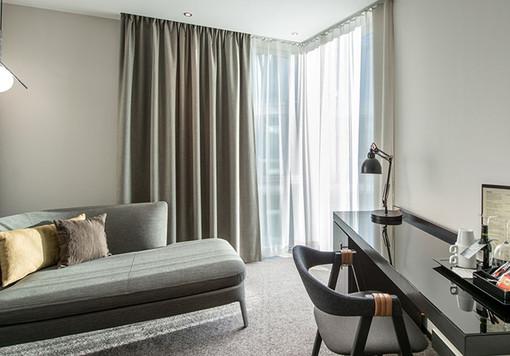 standard-room-sofa-pillows-workdesk-wind