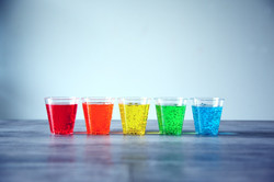 five-assorted-color-rock-s-glasses-on-gr