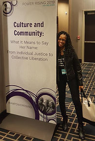 in front of sign for panel at power rising.jpg