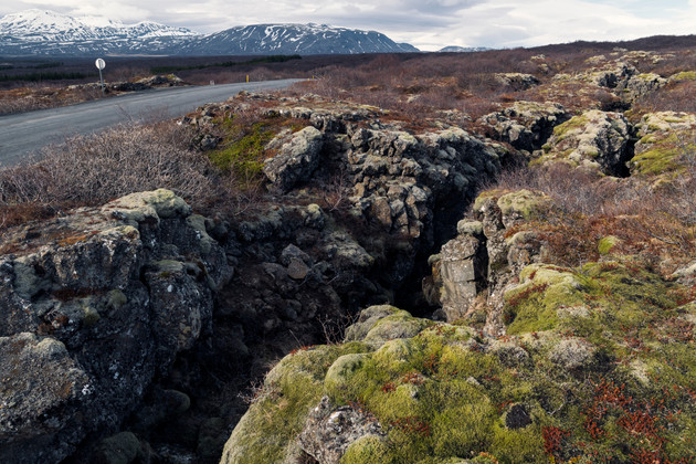 Crack in the Earth running through moss fields near Thingvellir National Park