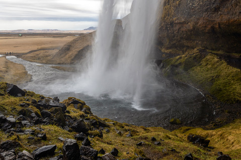 Behind Seljalandsfoss waterfall in Iceland