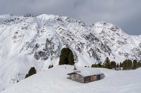Lonely wooden shelter at high altitude in the Alps