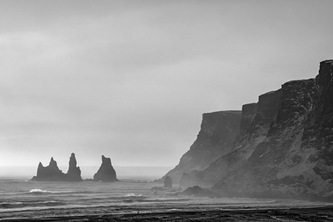 Waves rolling onto the black sand of Reynisfjara beach, Iceland South Region