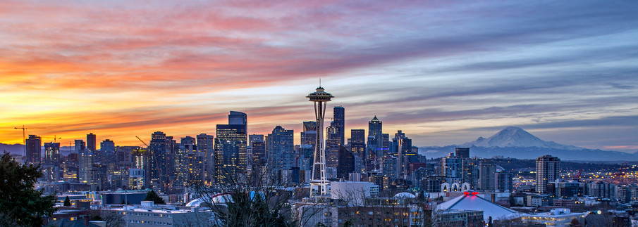 Seattle skyline at sunrise, with Mount Rainier in the background