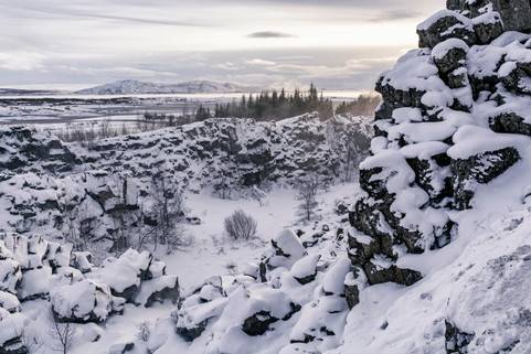 Mid Atlantic Ridge (rift valley): snow-covered edges of the North American and Eurasian tectonic plates at Thingvellir National Park