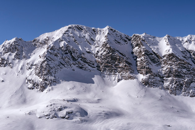 Snow covered mountain ridge of the French Alps on a clear sunny day
