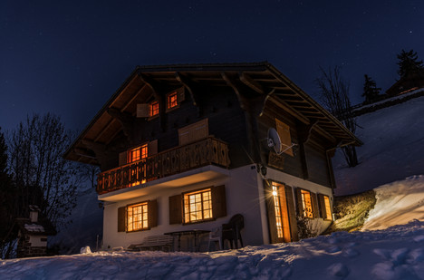 Alpine chalet at night