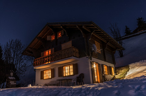 Alpine chalet at night