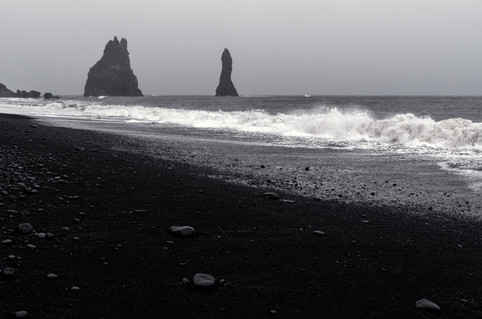 Reynisdrangar basalt sea stacks at Reynisfjara black sand beach in Iceland