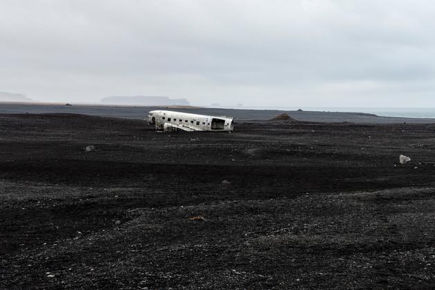 Plane wreck on the black sand beach, April