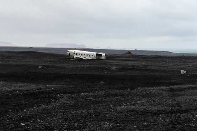 Plane wreck on the black sand beach, April