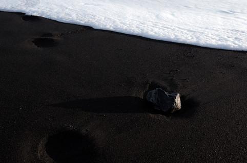 White foam on black sand, Reynisfjara black sand beach in Iceland