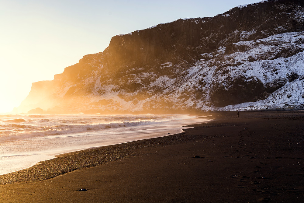 Sunset at Reynisfjara black sand beach near the coastal village of Vik in Iceland.