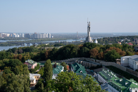 Motherland Monument over the city greenery