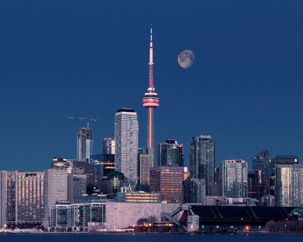 Toronto skyline at dawn, full moon behind the CN tower