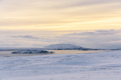 Sunrise sky over a field of ice and snow in Iceland