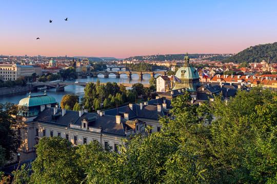 Prague rooftops and bridges at sunrise