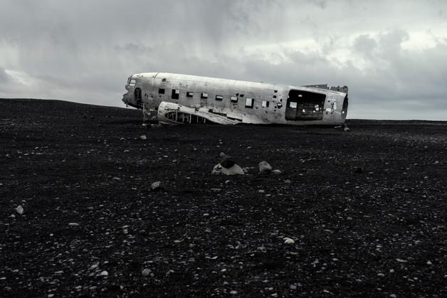 Plane wreck under a gloomy sky, April