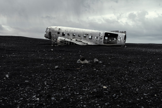 Plane wreck under a gloomy sky, April